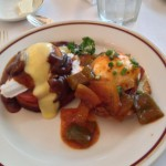 Eggs Hussarde & Eggs Adrienne Eggs Adrienne Poached eggs, grilled Louisiana country sausage on English muffins with Creole Sauce and Eggs Hussarde Poached eggs, Canadian bacon and tomato on French Bread crostini with Hollandaise and Marchand de Vin Sauces